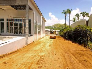 dirt being compacted by roller